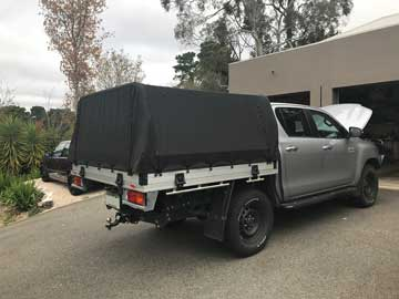 Dual Cab Hilux with Genuine Toyota Tray with rear ladder bar